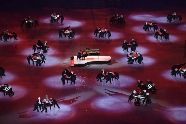 Pianist Denis Matsuev performs while pianos are moved around him during the closing ceremony for the 2014 Winter Olympics at Fisht Olympic Stadium in Sochi, Russia, Feb. 23, 2014. (Josh Haner/The New York Times)