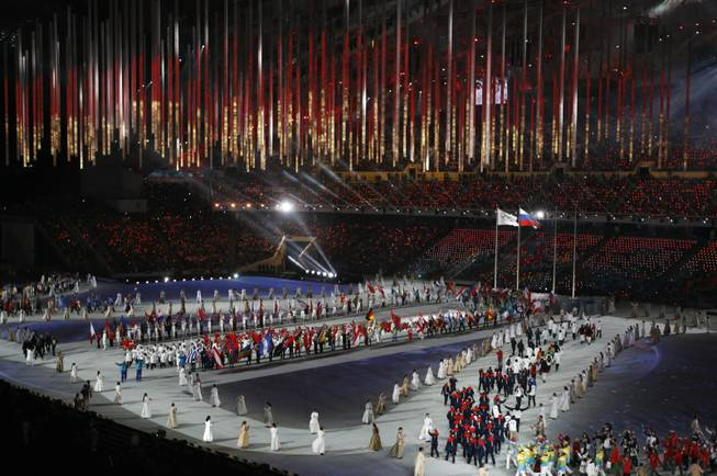 Athletes march into the arena during the closing ceremony of the 2014 Winter Olympics, Sunday, Feb. 23, 2014, in Sochi, Russia.