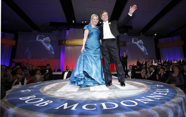 In this Saturday, Jan. 16, 2010 file photo, Virginia Gov. Bob McDonnell waves to the crowd along with his wife, Maureen during his inaugural ball in Richmond, Va. The former first lady of Virginia and her husband, former Gov. Bob McConnell, have been indicted on several counts of trading on their influence to enrich themselves and family members.