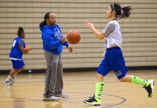 Coach Lonnie Cambell passes a ball to Heaven Heacock during practice at Desert Pines High School Monday, Feb. 24, 2014.
