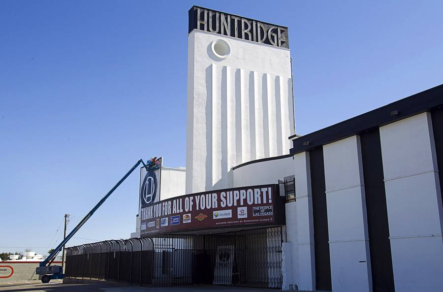 Workers hang a banner with a Huntridge logo at the Huntridge Theater at Maryland Parkway and Charleston Boulevard Monday, Feb. 24, 2014.