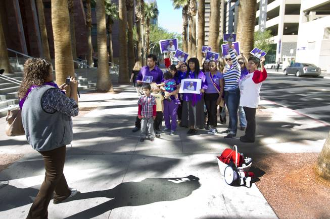 Rally members take a group photo as they try to increase awareness of domestic violence outside Clark County Regional Justice Center Monday, Feb. 24, 2014.