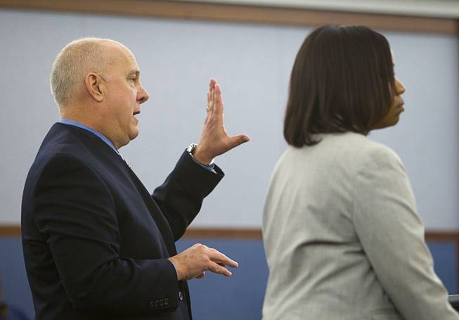 Prosecutors David Stanton, left, and Tierra Jones, make arguments to Judge Stefany Miley during a hearing for Elinor Indico at the Regional Justice Center Monday, Feb. 24, 2014. Indico is accused of stabbing her pregnant sister-in-law to death in October 2013.