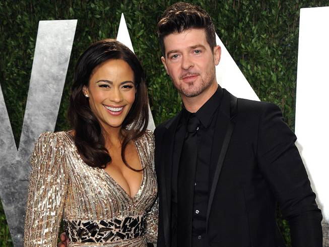 Paula Patton and Robin Thicke arrive at the 2013 Vanity Fair Oscars Viewing and After Party at the Sunset Plaza Hotel in West Hollywood, Calif., on Sunday, Feb. 24, 2013.