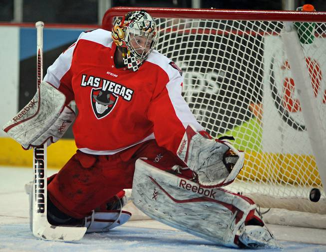 Las Vegas Wranglers goaltender Mitch O'Keefe watches as a Bakersfield Condors shot bounces off a post and into the back of his net during the first period of play on Tuesday night.