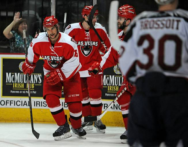 Wranglers forward Matt Tassone (16) skates towards the Las Vegas bench after scoring a short-handed goal against Bakersfield Condors goaltender Laurent Brossoit during the second period of play at the Orleans Areana on Tuesday night.