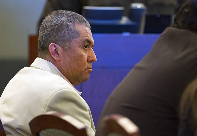 Armando Vergara-Martinez appears in court during his trial at the Clark County Regional Justice Center Tuesday, Feb. 25, 2014. Martinez is accused of attacking Maria Gomez with a machete in the parking lot of a North Las Vegas convenience store in 2012.
