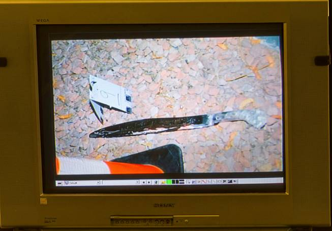 An evidence photo showing a machete is displayed on a video monitor during a trial for Armando Vergara-Martinez at the Clark County Regional Justice Center Tuesday, Feb. 25, 2014. Martinez is accused of attacking Maria Gomez with a machete in the parking lot of a North Las Vegas convenience store in 2012.