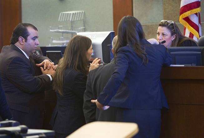 Judge Abbi Silver confers with attorneys during a trial for Armando Vergara-Martinez at the Clark County Regional Justice Center Tuesday, Feb. 25, 2014. Martinez is accused of attacking Maria Gomez with a machete in the parking lot of a North Las Vegas convenience store in 2012.