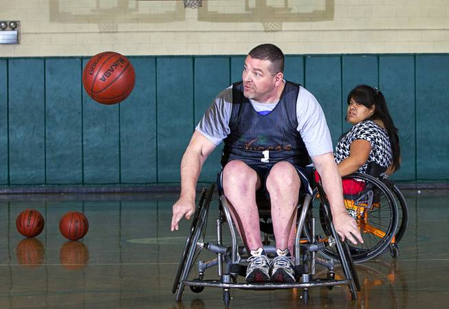 Marc Fenn chases after a loose ball during wheelchair basketball practice at Rancho High School Tuesday, Feb. 25, 2014. The team is practicing for a scrimmage against a Wounded Warriors team at Nellis Air Force Base on Thursday.