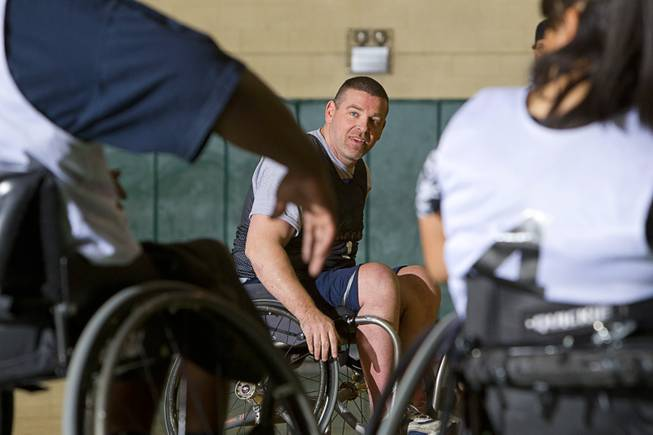 Marc Fenn, center, practices with his wheelchair basketball team at Rancho High School Tuesday, Feb. 25, 2014. The team is practicing for a scrimmage against a Wounded Warriors team at Nellis Air Force Base on Thursday.