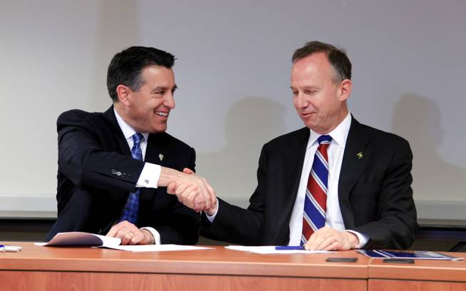 Nevada Gov. Brian Sandoval, left, and Delaware Gov. Jack Markell shake hands after signing the Multi-State Internet Gambling Agreement in the Delaware State Office Building in Wilmington Tuesday morning, Feb. 26, 2014.