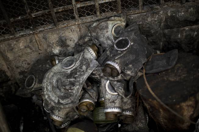 Gas masks from opposition supporters are seen next to a barricade in Kiev's Independence Square, the epicenter of the country's current unrest, Ukraine, Monday, Feb. 24, 2014.