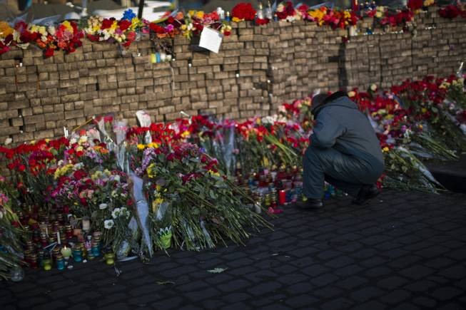 Flowers are seen placed at a barricade in Kiev's Independence Square, the epicenter of the country's current unrest, Ukraine, Monday, Feb. 24, 2014.