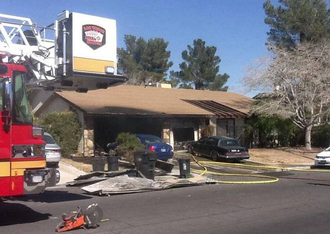 Las Vegas Fire & Rescue responded to a fire at 6308 O'Bannon Drive. Las Vegas Fire & Rescue spokesman Tim Szymanski said the fire on Tuesday, Feb. 25, 2014, destroyed two vehicles, damaged a third and displaced three residents.