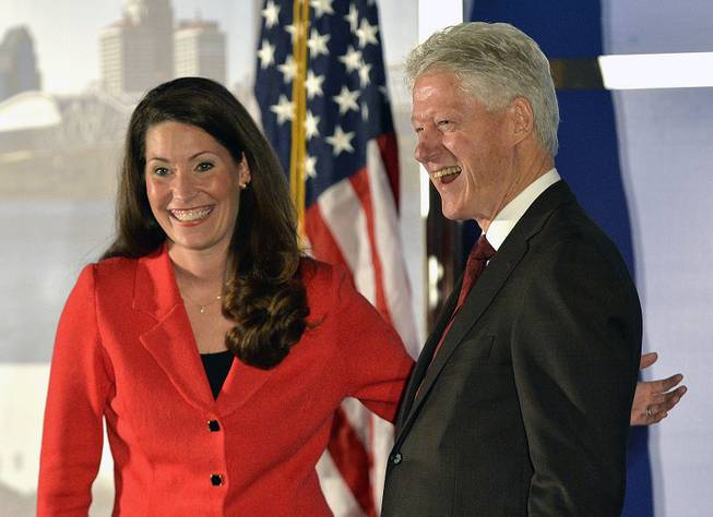 Democratic Senate challenger Alison Lundergan Grimes, left, speaks with former Presidet Bill Clinton as they are introduced at a fundraiser at the Galt House Hotel, Tuesday, Feb. 25, 2014, in Louisville, Ky.