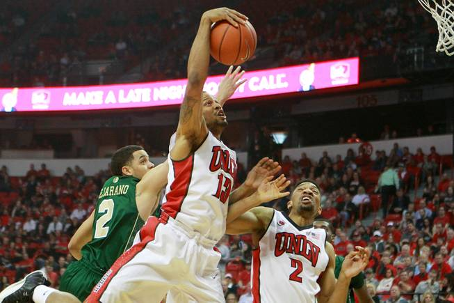 UNLV guard Bryce Dejean Jones pulls in a rebound against Colorado State during the first half of their Mountain West Conference game Wednesday, Feb. 26, 2014 at the Thomas & Mack Center.