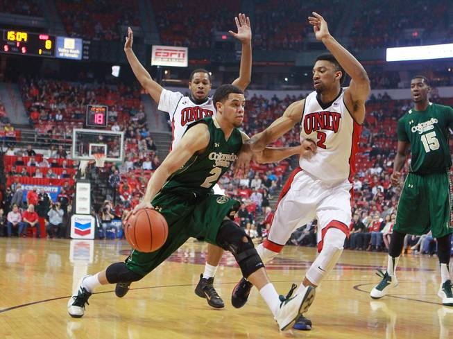 Colorado State guard Daniel Bejarano is defended by UNLV guard Jelan Kendrick, left, and forward Khem Birch during the first half of their Mountain West Conference game Wednesday, Feb. 26, 2014 at the Thomas & Mack Center.