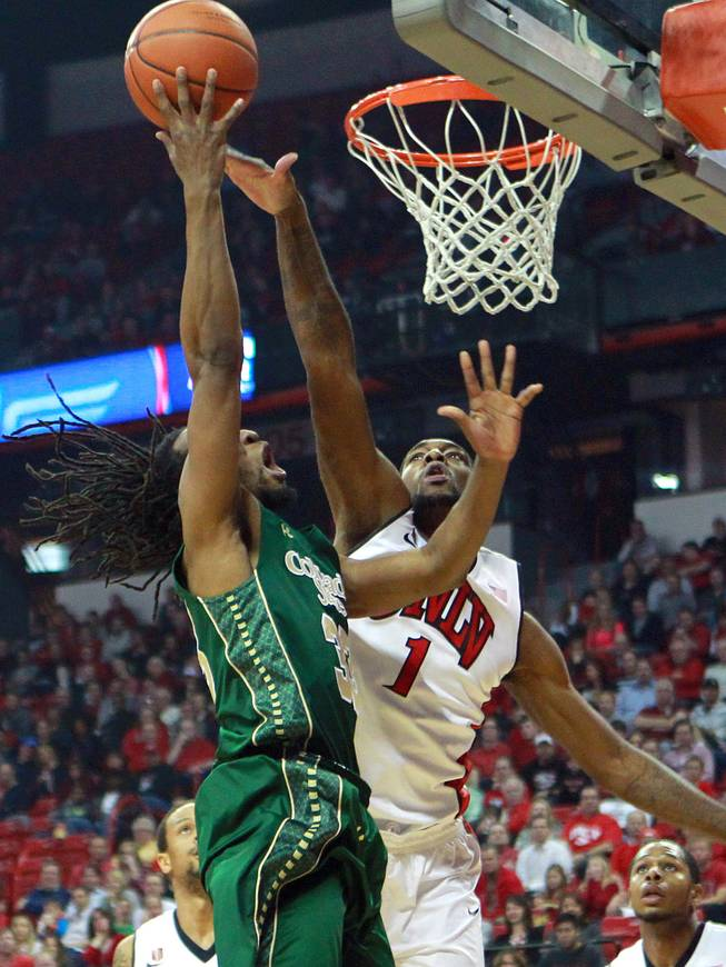 UNLV forward Roscoe Smith defends a shot by Colorado State Dwight Smith during the first half of their Mountain West Conference game Wednesday, Feb. 26, 2014 at the Thomas & Mack Center.