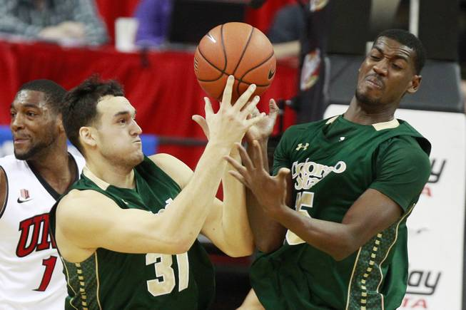 Colorado State forwards J.J. Avila and Gerson Santo ry to control a rebound during the first half of their Mountain West Conference game against UNLV Wednesday, Feb. 26, 2014 at the Thomas & Mack Center.