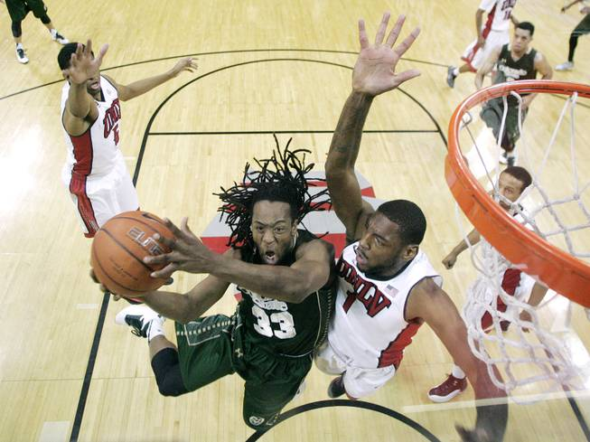 UNLV forward Roscoe Smith defends Colorado State guard Dwight Smith during their Mountain West Conference game Wednesday, Feb. 26, 2014 at the Thomas & Mack Center. UNLV won 78-70.