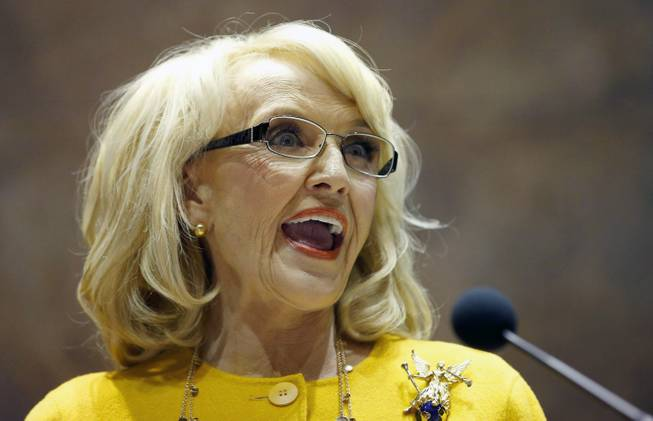 In this Jan. 13, 2014, photo, Arizona Gov. Jan Brewer speaks during her State of the State address at the Arizona Capitol in Phoenix.