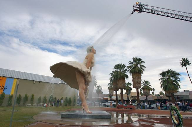 "This Jan. 23, 2013, file photo shows the ""Forever Marilyn"" sculpture getting a shower from the Palm Springs Fire Department in Palm Springs, Calif."