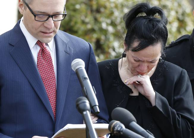 Attorney Michael Brooks-Jimenez, left, speaks at a news conference in Oklahoma City, Tuesday, Feb. 25, 2014. At right is Nair Rodriguez. At the news conference, the family of Luis Rodriguez, a man who died after a struggle with police outside an Oklahoma movie theater, released a cellphone video of the incident that shows the man on his stomach on the ground with five officers restraining him, including one officer holding his head down.