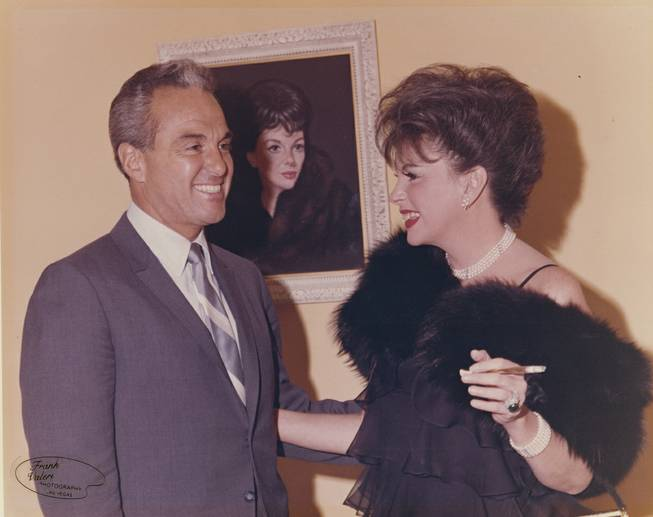 Stan Irwin was not only a producer and actor, but he helped bring the .Beatles, and, as shown here, Judy Garland to Las Vegas.  She played at 2am  at the Sahara, drawing capacity crowds even at that hour.  The two are  shown here in front of a portrait of Garland at the Thunderbird Hotel on  June 27, 1965.
