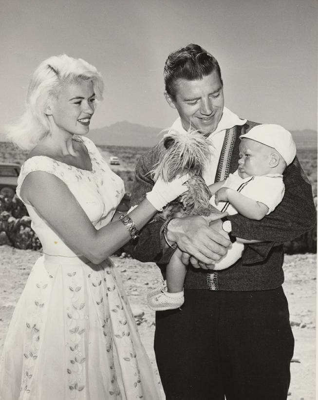 Jayne Mansfield and Mickey Hargitay with their son Zoltan, their second of three children, in May 1961, photographed while managing the building of their home near Sunrise Mountain.  Zoltan was later attacked by a lion at Jungeland USA in Thousand Oaks, CA.  He survived, but the bad publicity ultimately forced the theme park to close.