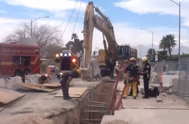 Las Vegas Fire & Rescue crews attempt to rescue a worker who was injured and trapped under a piece of heavy equipment in a 20-foot-deep trench in the 5400 block of Vegas Drive on Wednesday, Feb. 26, 2014.