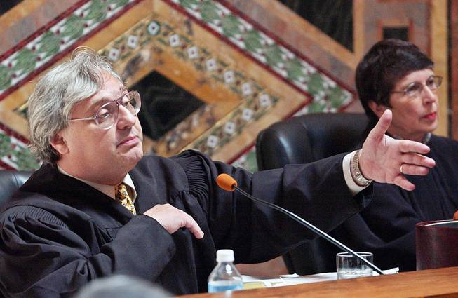 Judge Alex Kozinski of the 9th U.S. Circuit Court of Appeals gestures as Chief Judge Mary Schroeder looks on in San Francisco, Sept. 22, 2003.