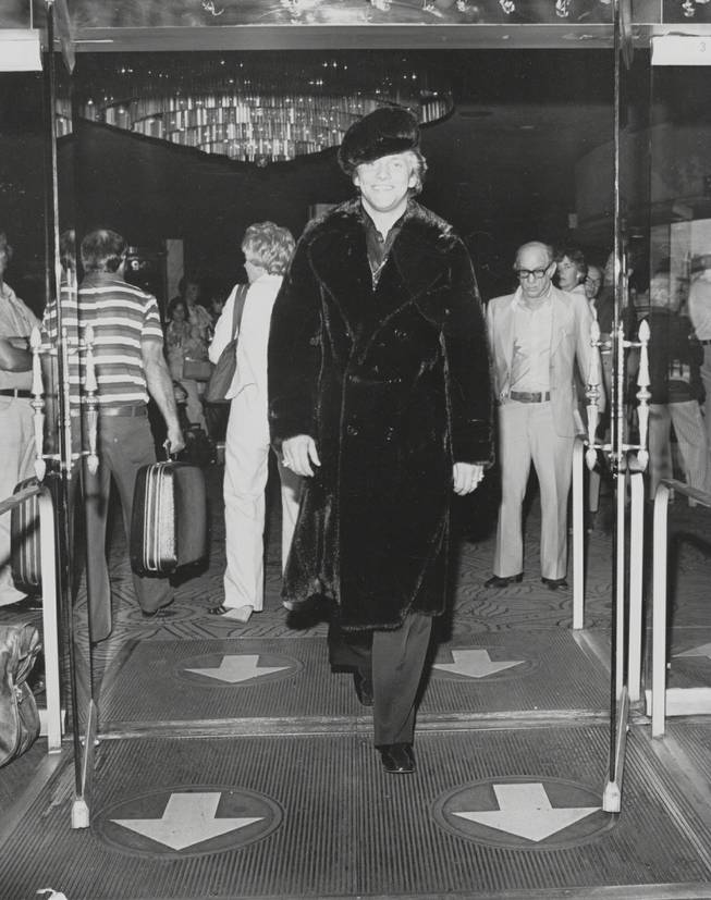 Scott Thorson leaves the Dunes Hotel, still wearing the black llama .jacket and cap he modeled there for Anna Nateece's fashion show.  Scott was Liberace's lover (played recently by Matt Damon in 'Behind the Candelabra)  and Anna was Liberace's gown and fur designer.  Circa 1980.  Courtesy Anna Nateece's.