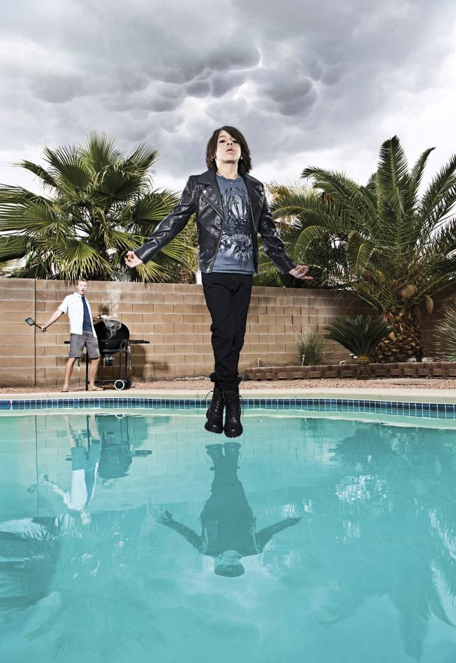 Mindfreak star Criss Angel (photographed by Eric Ita) is well known for levitating above the Luxor, home of his Believe show and CRISS ANGEL MAGICjam. Xavier, 10, takes a cue from the illusionist, floating over the pool as dad Range looks on.