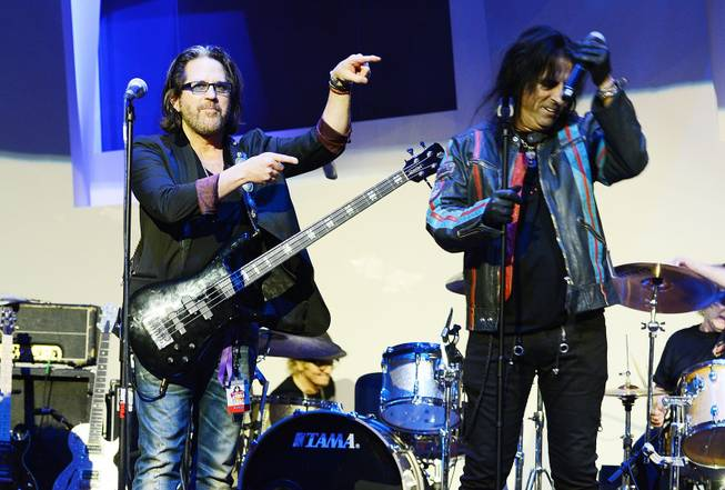 "Kip Winger and Alice Cooper perform during the Kerry Simon ""Simon Says Fight MSA"" benefit concert at the Keep Memory Alive Center in Las Vegas on Feb. 27, 2014."