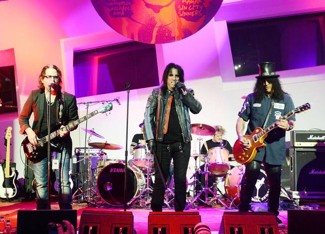 "Kip Winger, Alice Cooper and Slash during the Kerry Simon ""Simon Says Fight MSA"" benefit concert at The Keep Memory Alive Center in Las Vegas on Feb. 27, 2014."