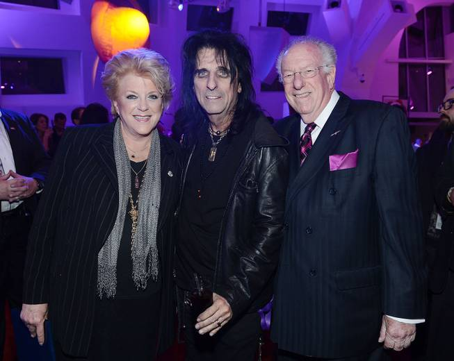 Las Vegas Mayor Carolyn G. Goodman and former Las Vegas Mayor Oscar Goodman flank Alice Cooper during the Kerry Simon Says Fight MSA benefit at Keep Memory Alive event center Thursday, Feb. 27, 2014, in downtown Las Vegas.