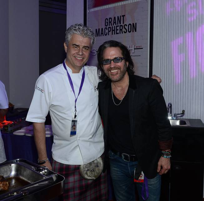 "Chef Grant Macpherson and Kip Winger attend the Kerry Simon ""Simon Says Fight MSA"" benefit concert at The Keep Memory Alive Center in Las Vegas on Feb. 27, 2014."