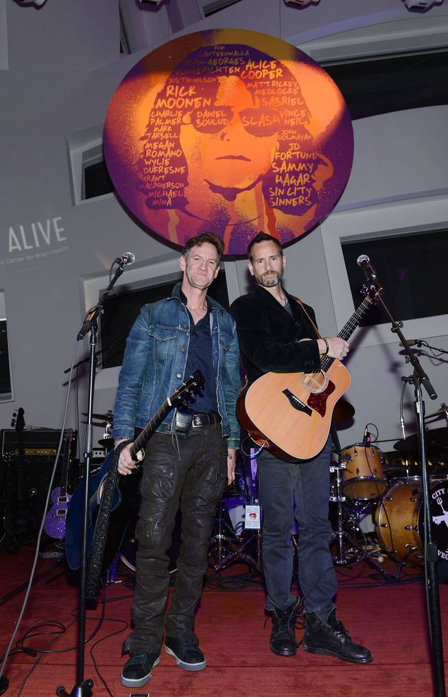 "Mark Seliger and Michael Duff perform at ""Simon Says Fight MSA"" benefit concert at The Keep Memory Alive Center in Las Vegas on Feb. 27, 2014."