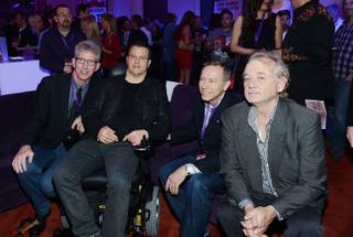 Kerry Simon, second from left, and Bill Murray, right attend the Simon Says Fight MSA benefit at Keep Memory Alive event center Thursday, Feb. 27, 2014, in downtown Las Vegas.