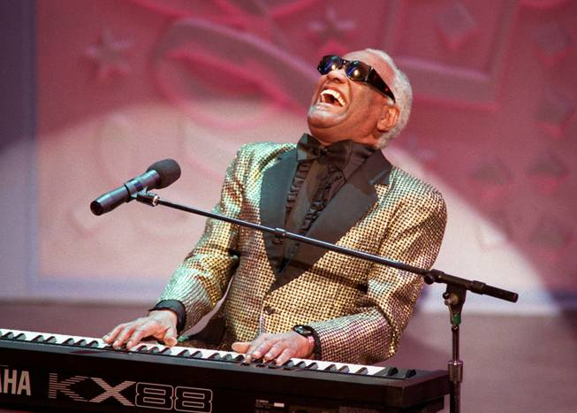 "Blues singer Ray Charles sings ""Oh What a Beautiful Morning"" in this March 3, 1996, file photo in Pasadena, Calif. during the 25th annual Easter Seal fundraiser event. Charles, the Grammy-winning crooner who blended gospel and blues in such crowd-pleasers as ``What'd I Say'' and heartfelt ballads like ``Georgia on My Mind,'' died June 10, 2004. He was 73."