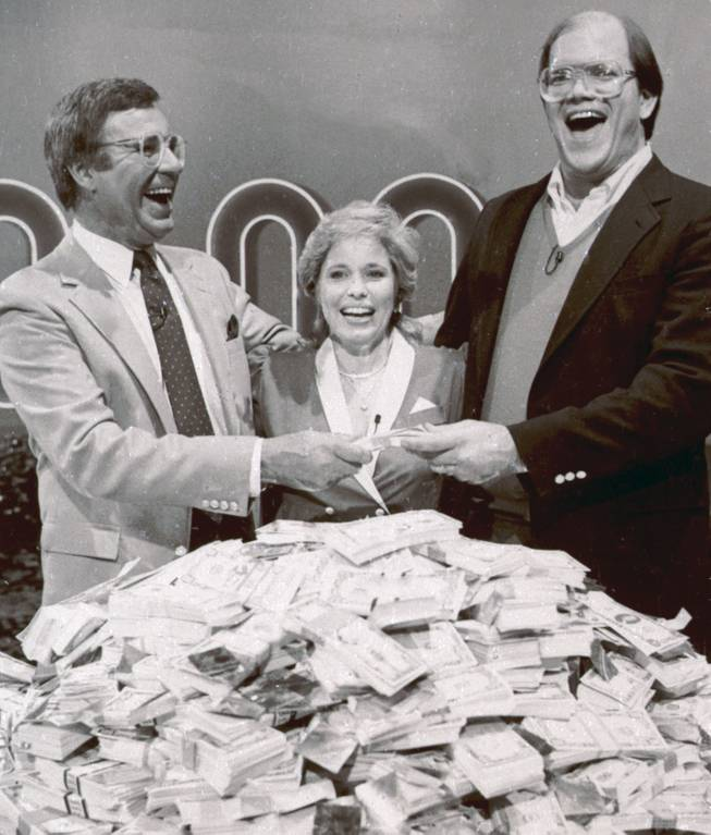 "This Jan. 16, 1986, file photo shows host Jim Lange, left, congratulating Connie and Steve Rutenbar of Mission Viejo, Calif., after they won $1 million on the TV show ""The $1,000,000 Chance of a Lifetime."" Lange, the first host of the popular game show ""The Dating Game,"" has died at his home in Mill Valley, Calif. He was 81."