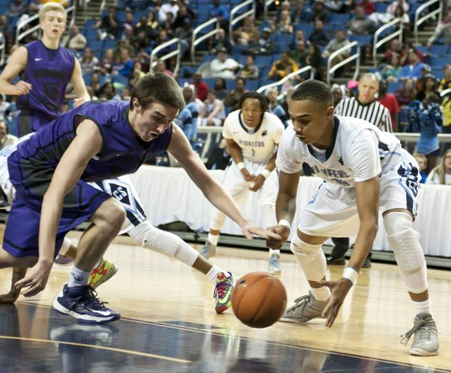 Gerad Davis reaches for the ball against a defender Thursday, Feb. 27, 2014 as Canyon Springs defeats Spanish Springs 66-51 in the semifinals of the Nevada State Championships at Lawlor Events Center in Reno.