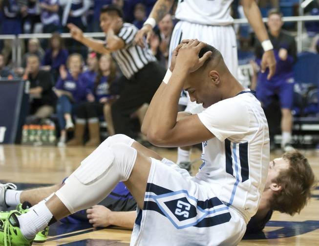 Gerad Davis grips his head in frustration after being called for a charge in the first half Thursday, Feb. 27, 2014 as Canyon Springs defeats Spanish Springs 66-51 in the semifinals of the Nevada State Championships at Lawlor Events Center in Reno.