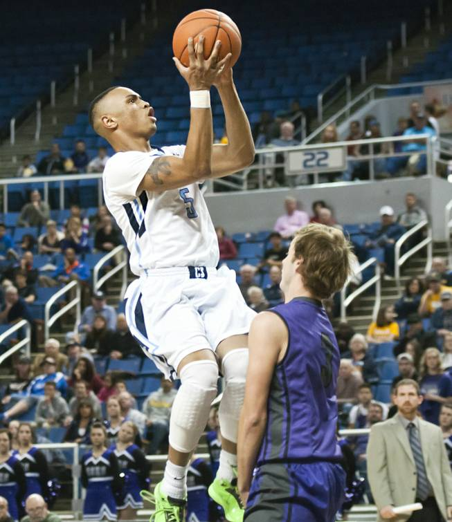 Gerad Davis eyes the hoop for a layup as a defender sneaks in beneath him Thursday, Feb. 27, 2014 as Canyon Springs defeats Spanish Springs 66-51 in the semifinals of the Nevada State Championships at Lawlor Events Center in Reno.