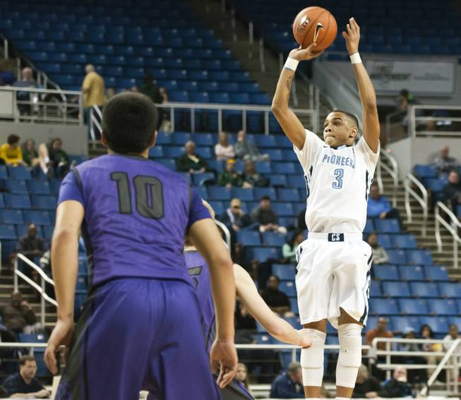 Jordan Davis pulls up for a mid-range jumper Thursday, Feb. 27, 2014 as Canyon Springs defeats Spanish Springs 66-51 in the semifinals of the Nevada State Championships at Lawlor Events Center in Reno.