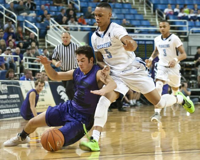 Gerad Davis, right, hustles after a ball as Hunter Pinto dives to the floor Thursday, Feb. 27, 2014 as Canyon Springs defeats Spanish Springs 66-51 in the semifinals of the Nevada State Championships at Lawlor Events Center in Reno.