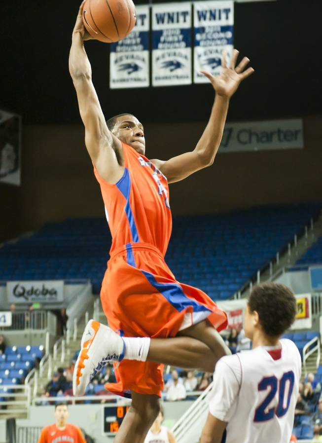 Nick Blair rises above a defender for a one-handed jam Thursday, Feb. 27, 2014 as Bishop Gorman defeats Reno 68-27 in the semifinals of the Nevada State Championships at Lawlor Events Center in Reno.