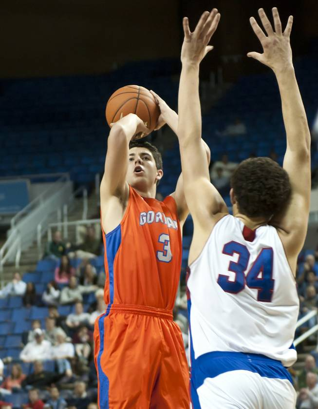 Tanner Leishman pulls up for a jumper just in front of the three point line Thursday, Feb. 27, 2014 as Bishop Gorman defeats Reno 68-27 in the semifinals of the Nevada State Championships at Lawlor Events Center in Reno.