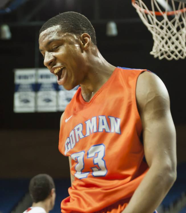 Nick Blair lets out a triumphant yell after a one-handed dunk Thursday, Feb. 27, 2014 as Bishop Gorman defeats Reno 68-27 in the semifinals of the Nevada State Championships at Lawlor Events Center in Reno.